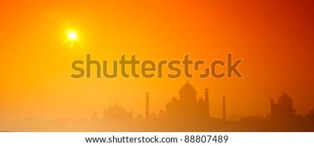 Panorama of Taj mahal in the mist - stock photo