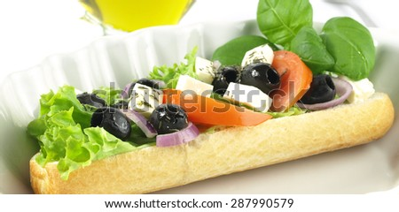 Panorama of tasty vegetarian sandwich with olives and feta - stock photo
