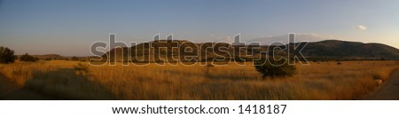 Panorama of the African emtyness of wildlife scenery. - stock photo