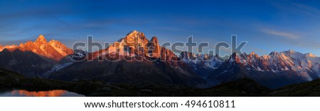 Panorama of the Alps, with Aiguille Verte and Les Drus, near Chamonix during sunset.