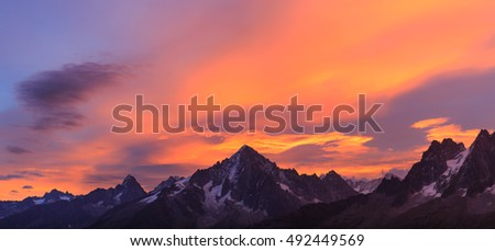 Panorama of the Alps, with Les Drus and Auguille Verte, near Chamonix during a colorful sunrise.