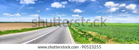 Panorama of the asphalt road in a beautiful sunny autumn day - stock photo