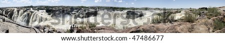 Panorama of the Augrabies Waterfall in the Orange River near Kakamas, Northern Cape Province, South Africa in flood after heavy rains in the catchment areas of the Orange River - stock photo