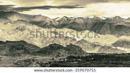 Panorama of the beautiful mountains that surround Leh in the valley of the Indus river - Tibet, Leh district, Ladakh, Himalayas, Jammu and Kashmir, Northern India (stylized retro) - stock photo
