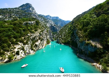 panorama of the canyon in the Verdon Gorge in southern France with the river by the color blue and boats and canoes tourists