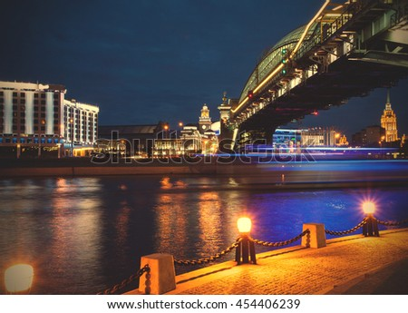 panorama of the city at night from the Bridge of Bogdan Khmelnitsky and the Moscow River in the area of the Kiev station. Moscow, Russia. instagram image filter retro style - stock photo