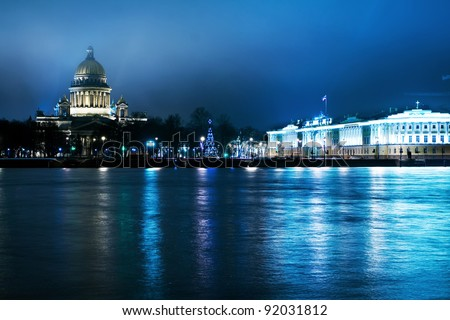 Panorama of the city at night (St. Petersburg), which is reflected in the river (Neva River), Russia - stock photo