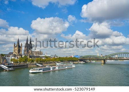 panorama of the city Cologne with cathedral, boats, river Rhine and bridge in a sunny day, Germany