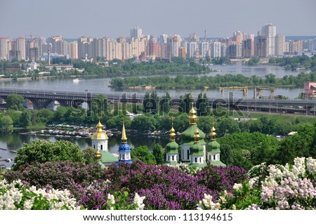 Panorama of the city of Kiev. Ukraine. View of the monastery Vydubitsky, left bank of the Dni?p?r River and the modern part of town. Kyiv. - stock photo