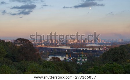 Panorama of the city of Kiev. Ukraine. View of the monastery Vydubitsky, left bank of the Dnieper River and the modern part of town. Kyiv. Evening Kiev. - stock photo