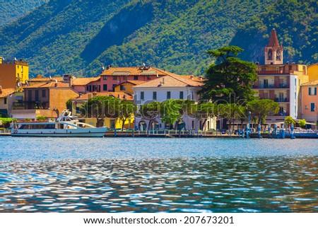 Panorama of the city Sulzano, a bright sunny day. Italy, the Alps, Lake Iseo. - stock photo