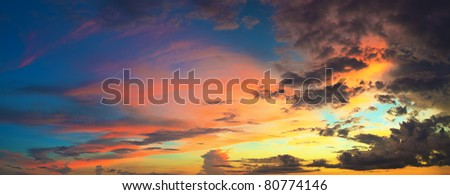 Panorama of the cloudy sky at sunset time - stock photo