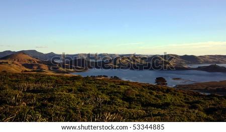 Panorama of the coastal landscape of Hoopers Inlet on the Otago Peninsula, New Zealand - stock photo