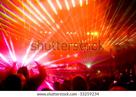 Panorama of the concert, laser show and music, blurred motion - stock photo