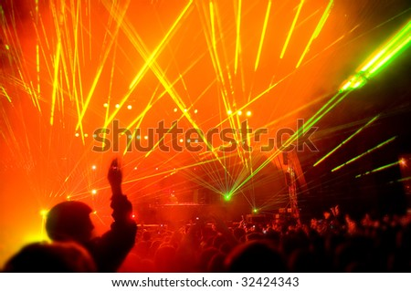Panorama of the concert, laser show, blurred motion - stock photo