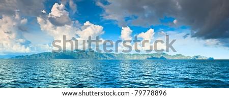 Panorama of the Coron island with cloudy sky - stock photo