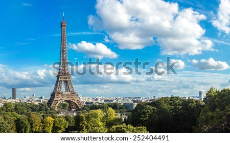 Panorama of the Eiffel Tower in Paris, France in a beautiful summer day - stock photo