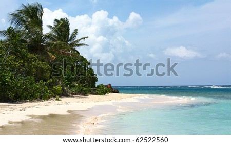 Panorama of the gorgeous white sand filled Flamenco beach on the Puerto Rican island of Culebra. - stock photo