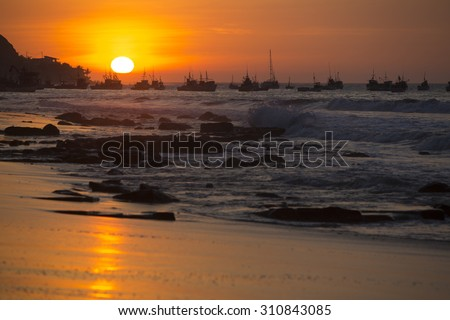 Panorama of the harbor of Manora during a wonderful orange sunset. Peru 2015 - stock photo
