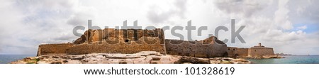Panorama of the imposing  seaward view of a fort guarding the entrance to the Grand Harbour of Valletta - stock photo