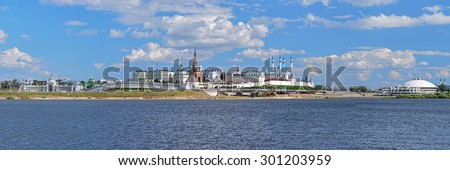 Panorama of the Kazan Kremlin, Russia. The panorama shows in Kremlin: Presidential Palace, Soyembika Tower, Annunciation Cathedral, Qolsharif Mosque; outside Kremlin: Palace of Farmers and Circus. - stock photo