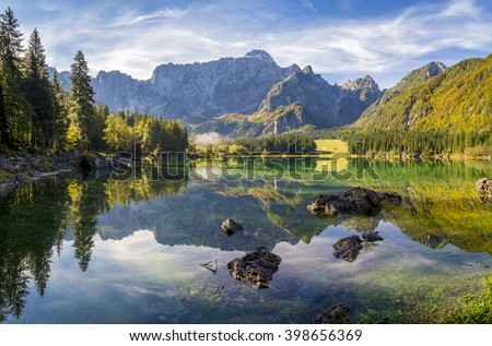panorama of the lake in the Alps - stock photo