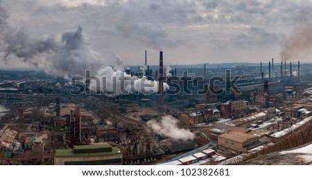 Panorama of the metallurgical factory with pipes and smoke, atmosphere pollution - stock photo