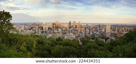 Panorama of the Montreal Skyline at dusk, taken from the top of Mont Real, Quebec Province, Canada. - stock photo