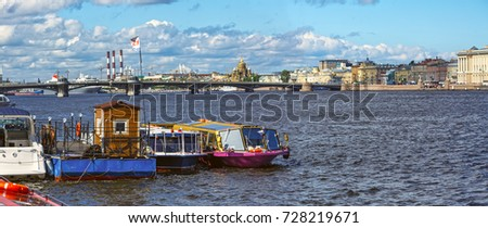 Panorama of the Neva river: view of the pier for river vessels. Saint Petersburg, Russia.