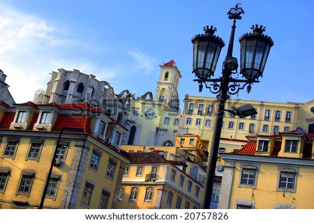 Panorama of the old Lisbon with its typical houses and street lamps - stock photo