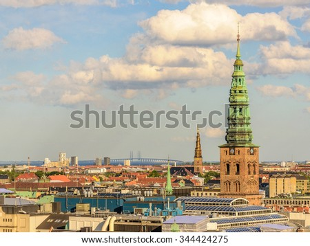 Panorama of the old part of the city and famous towers (Church of Our Saviour) of Copenhagen and bridge from the observation deck at the Round tower (Rundetaarn) in Copenhagen, Denmark - stock photo