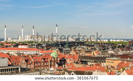 Panorama of the old part of the city and industrial cityscape and bridge from the observation deck at the Round tower (Rundetaarn) in Copenhagen, Denmark