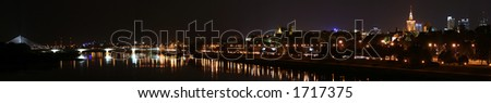 Panorama of the Old Town and downtown Warsaw over Vistula river - stock photo