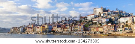 Panorama of the Ribeira District of the city of Porto, Portugal, and the Douro River seen from the city of Vila Nova de Gaia during sunset. Unesco World Heritage Site - stock photo