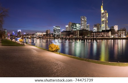 Panorama of the river Main at Frankfurt, Germany, with the city skyline at dusk. - stock photo