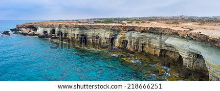 Panorama of the scenic coast of Famagusta bay with the white cliffs and caves, named Cavo Greco, Ayia Napa, Cyprus. - stock photo