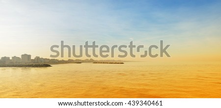 panorama of the sea at sunset in summer - stock photo