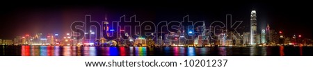 Panorama of the skyline of Victoria harbor in Hong Kong at night. - stock photo