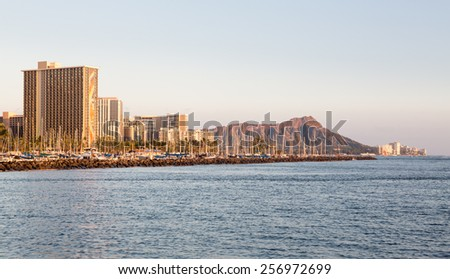 Panorama of the skyline of Waikiki at sunset or dusk with yachts and boats in Ala Moana harbor and Hilton Hawaiian Village framing Diamond Head in Waikiki, Oahu, Hawaii - stock photo