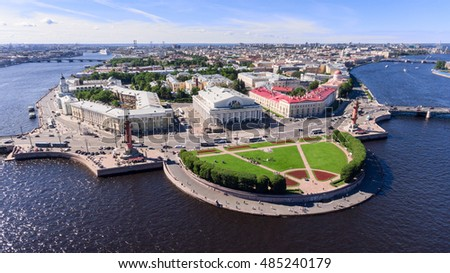Panorama of the spit of Vasilyevsky island with Rostral columns and old stock Exchange. Aerial view. The Neva river, St. Petersburg, Russia