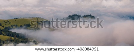 Panorama of the summer morning in the foggy Carpathian mountains. Ukraine, Europe. - stock photo