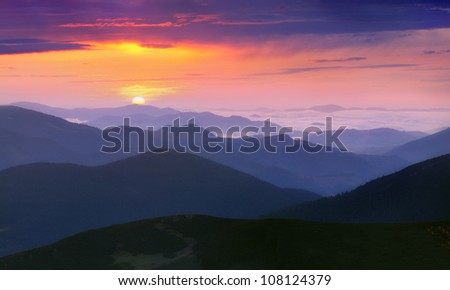 Panorama of the sunrise in the mountains - stock photo