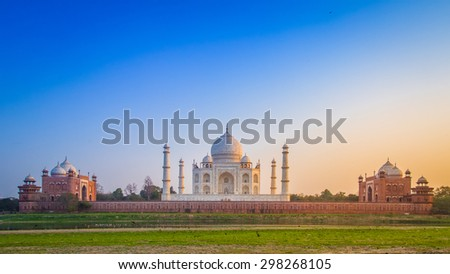 Panorama of the Taj Mahal from north side across the Yamuna river at sunset. - stock photo