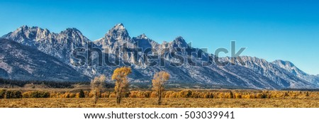 Panorama of the Tetons from highway 191 in autumn in Wyoming USA.