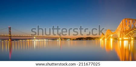 Panorama of the tow bridges over the Firth of Forth in Scotland at dawn - stock photo