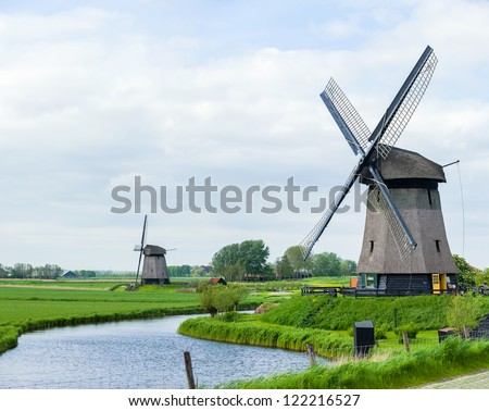 Panorama of the traditional Dutch windmill near the channel. Netherlands. Panorama