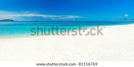 Panorama of the tropical sandy beach Malcapuya - stock photo