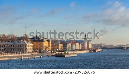 Panorama of The Universitetskaya Embankment on the right bank of the Bolshaya Neva river, Vasilievsky Island, Saint Petersburg, Russia - stock photo