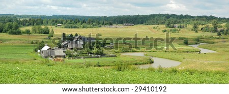 Panorama of the village by the river - stock photo