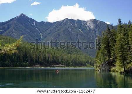 panorama of the whiteswan lake with a canoe - Located in the Kootenay Range of the Rocky Mountains, BC, Canada